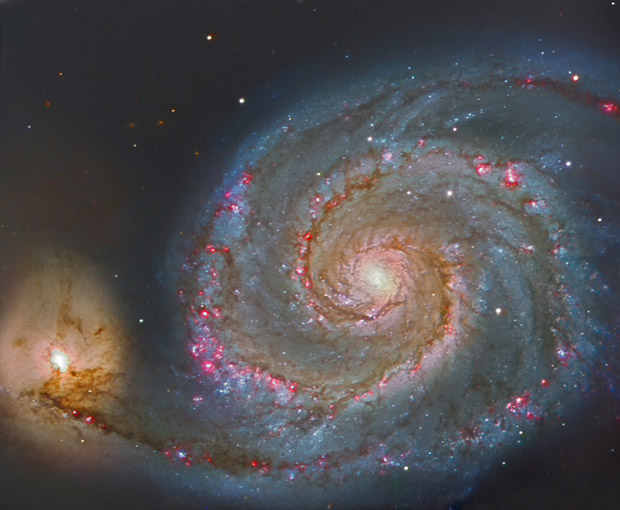 Three-colour composition image of M51, the Whirpool galaxy. Located 23 million light years away, this magnificent spiral was observed using the instrument OSIRIS at the GTC, with an exposure time of 120 seconds. To reach a similar depth using a 1m telescope, an exposure time of more than three hours would be required. Credits: OSIRIS / Daniel L�pez (IAC)